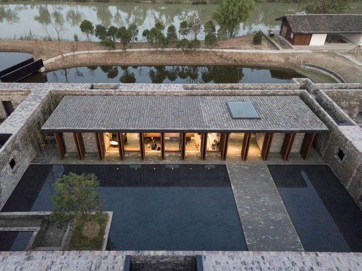 Neri&Hu introduced a grid of brick walls and pathways that tie the old and new spaces together, and transform the site a cluster of interconnected rooms and courtyards.