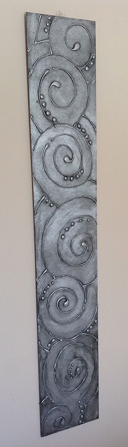 Hot Glue Gun Art - Spray painted with Metallic Silver, distressed with black paint - giving it an antique metal look.: