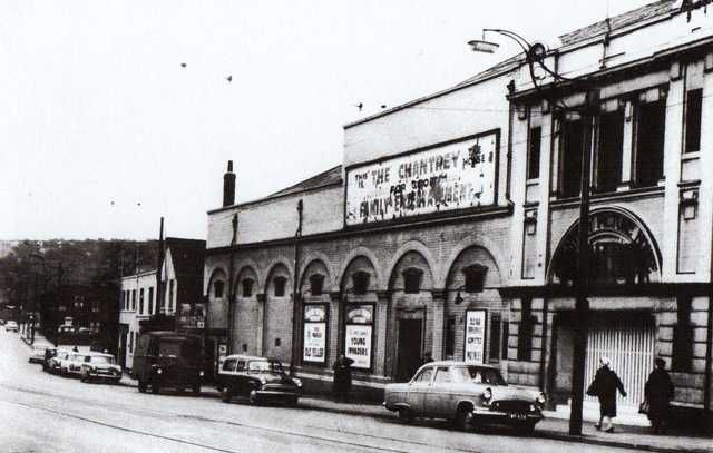 """The Chantrey Picture House was located in the Woodseats district of Sheffield. It opened on 22nd May 1920 with """"The Crimson Gardenia"""" and a Charlie Chaplin short. It was built by the local builder M.J. Gleeson and had a series of ornamental brick arches along the Chesterfield Road frontage, to which the auditorium block ran parallel, while above the entrance on the extreme right of the building extensive use of terracotta was used.  Seating capacity was for 1,400 in stalls and balcony and…"""