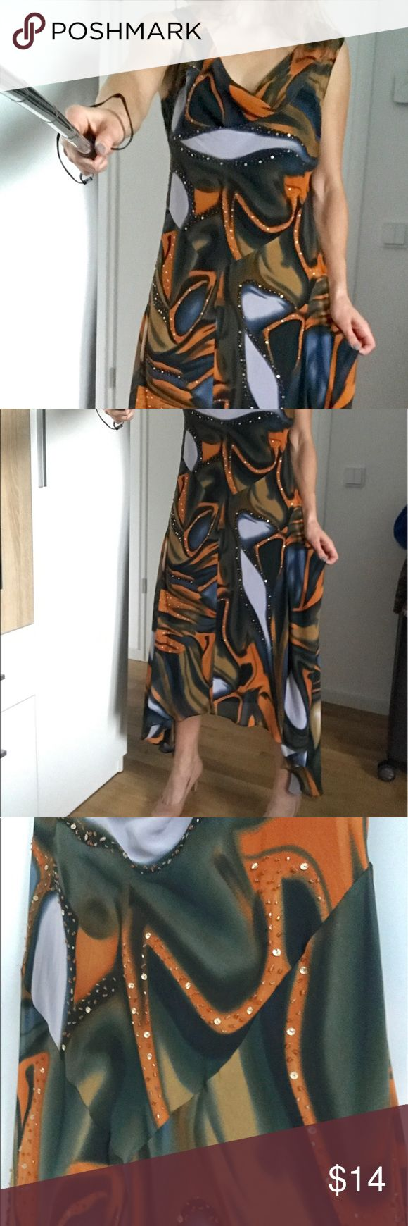 Elegant Multi-colored Evening Dress, fits M & L. This beautifully designed evening dress has a very soft feel and vibrant pattern. It can be worn to a formal event or on a warm summer day. Fits both sizes M & L. Dresses