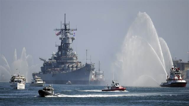The USS Iowa makes her way through the main channel of the Port of Los Angeles to her permanent home, Berth 87, in San Pedro