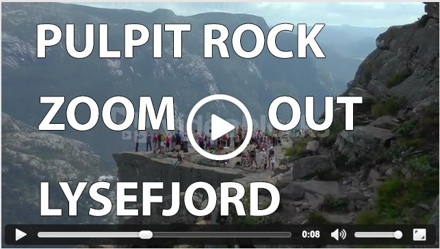 Zooming out on Pulpit Rock, Preikestolen, overviewing Lysefjord and the mountains in Rogaland