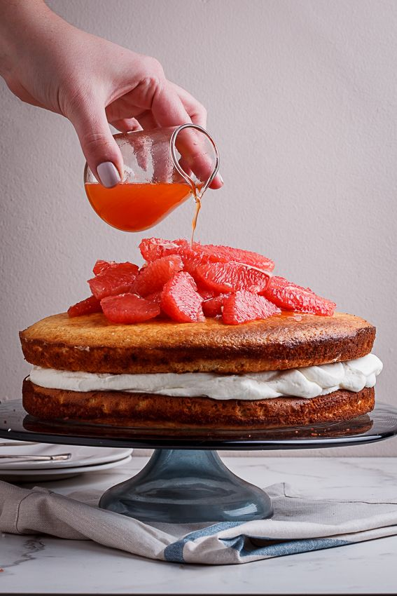 Flavourful, fragrant grapefruit, almond and yoghurt cake with lightly-sweetened whipped cream and fresh grapefruit is the perfect Summer dessert.
