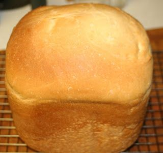 Best Bread Machine White Bread - 1 1/3 cups warm water, about 110 degrees, 2 Tablespoons and 2 teaspoons white sugar, 3 teaspoons yeast, 1/3 cup Olive Oil, 4 cups flour (or 1.5 cups whole wheat flour and 2.5 cups bread flour), 2 teaspoons salt