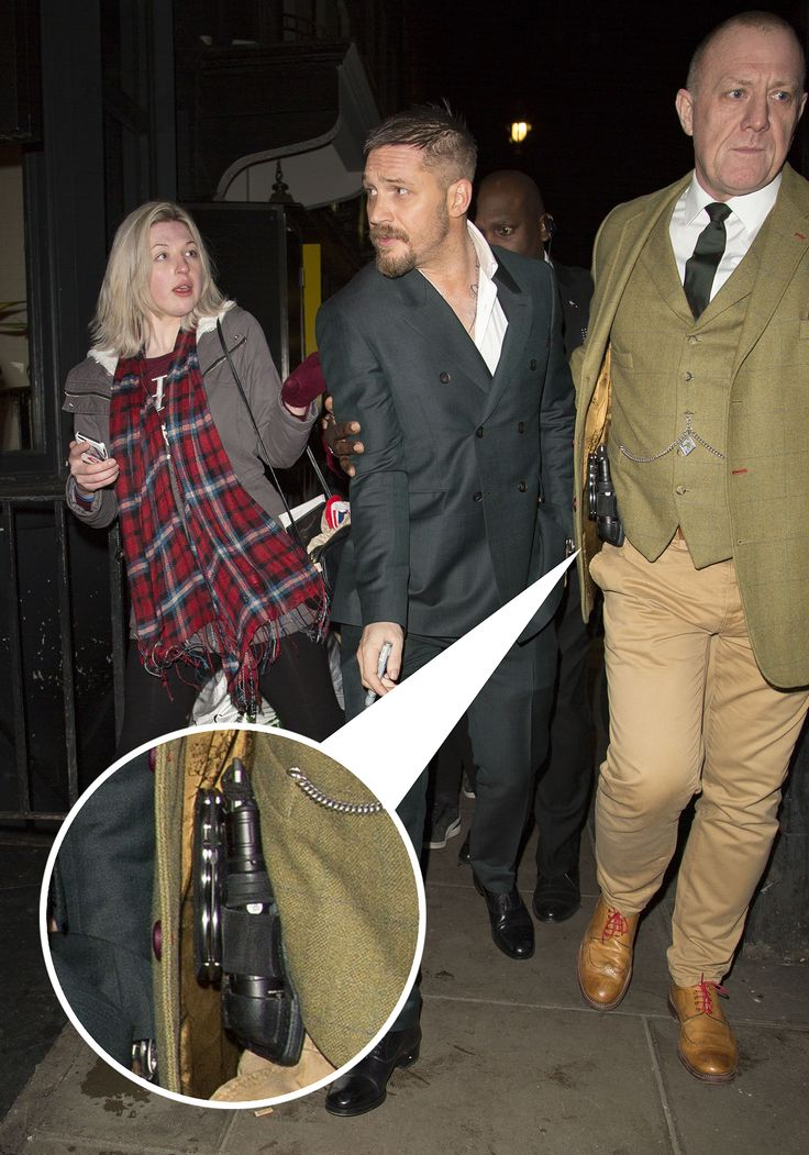 om Hardy January 15, 2016 Tom & His Bodyguard... Tom hardy was mobbed by fans, as he left 'The Revenant' UK premiere after party held at the Groucho Club in Soho, London. His well dressed security guard was carrying a holster full of tools, including a jack knife. Tom Hardy left at 1am and