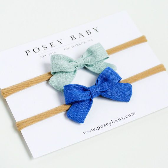 The sweetest mini bow headbands for baby girls, perfect small bow size for newborns. Made from the finest 100% linen in cheerful shades of harbor green and marina blue. Soft nylon band that fits newborn to young girls. Hand-sewn into the perfect mini bow with a beautiful finish that is guaranteed to last. Each bow measures about 2 wide.  • 100% linen • Color - harbor green & marina blue • Soft nylon headband • Handmade • Bow is 2 wide • Listing includes 2 bows
