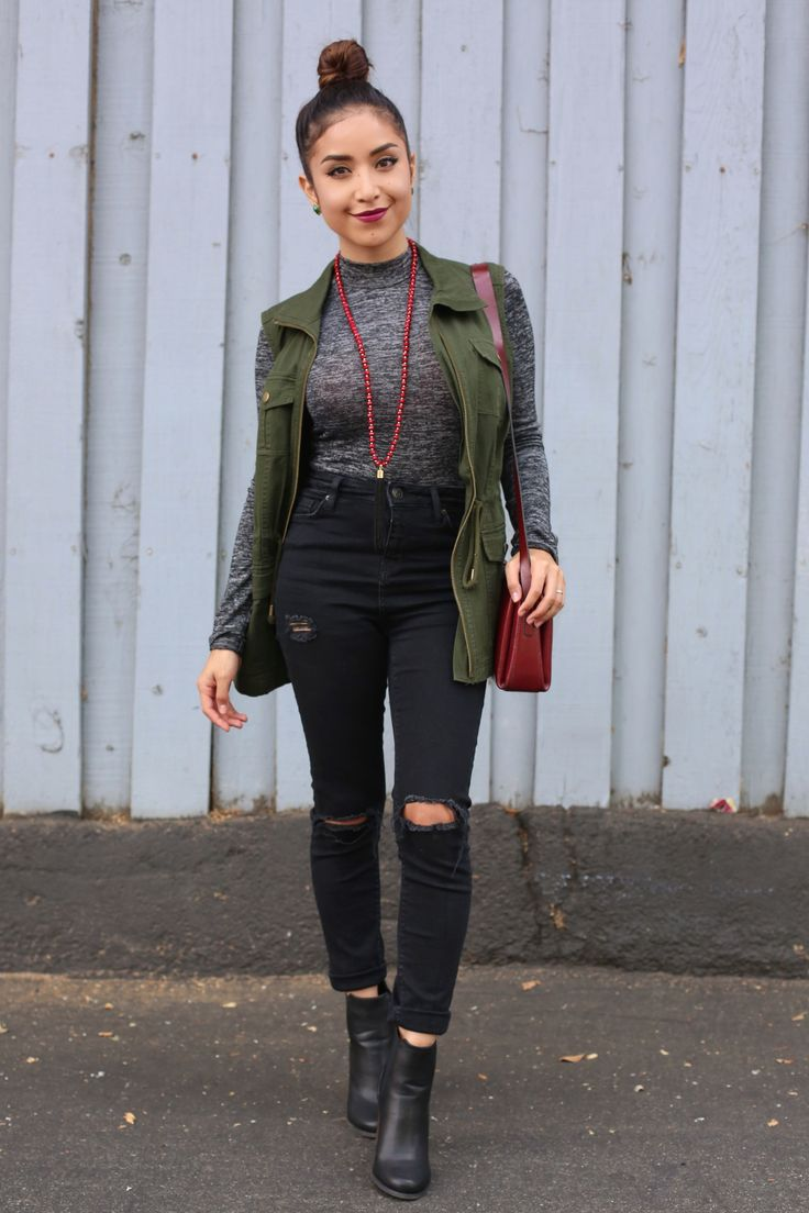 AUTUMN LAYERS: Gray turtleneck, green military vest, black high waist jeans, booties