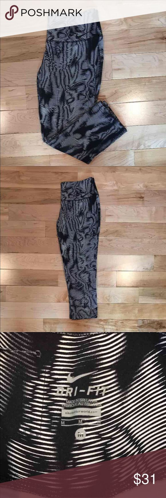 Nike Legend Capri/Legging Nike Legend Capri leggings. Dri-fit material. Nice thick athletic Capri. Great for running, gym workouts, and yoga. Colors are black, and white. Size medium. Nike Pants Leggings