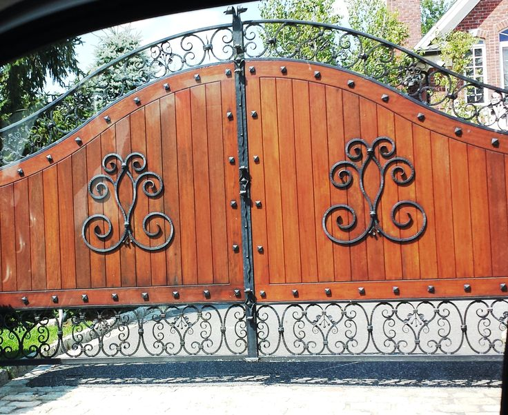 Decorative automated wrought iron and wood entrance gate