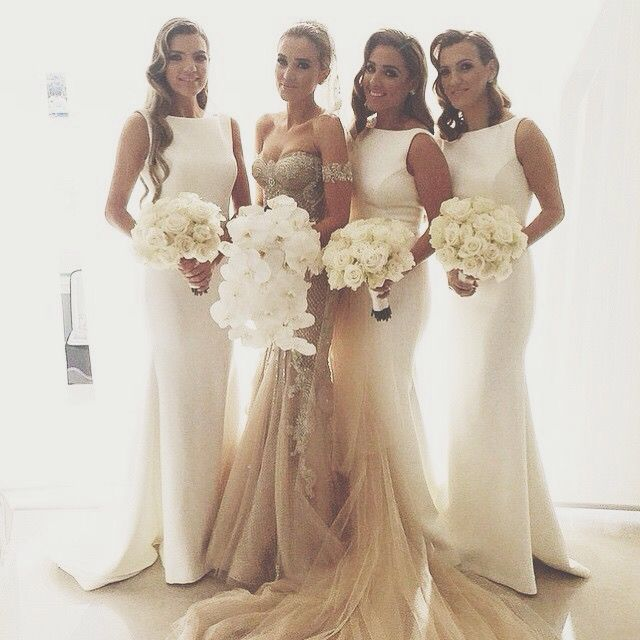 Bridesmaids All Wear White Against Coloured Bride Dress