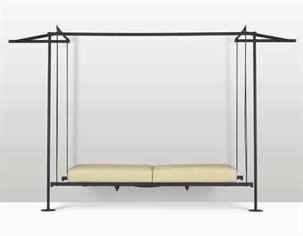 PIERRE CHAREAU (1883-1950) SUSPENSION SEAT, CIRCA 1925 model 'EF 928', iron 78¾ in. (200 cm.) high, 90½ in. (230 cm.) wide, 36 5/8 in...