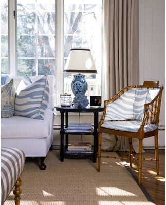 Perfect little blue, cream, and tan living room vignette by Lee Ann Thornton. Love the blue and white ginger jar style lamp, the tan and cream buffalo check ottoman, that terrific tan bamboo chair, and, of course, the blue zebra print is really what makes this composition. Traditional, friendly, and fresh.