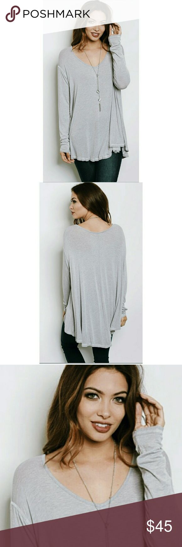 ⭐Luxe V-Neck Jersey Tunic GREY Essential Wardrobe Piece Luxe Soft & Comfy - The Perfect T-Shirt!  My personal favorite!  ❤☄❤  High Quality Fabric  Lightweight - Perfect for spring! Fabric Content: 83% Rayon  9% Polyester 8% Spandex  Made in the U.S.A. S-M-L  True to size   ▪ Price is Firm  ▪ No Trades  ▪ Fast Shipping Moda Ragazza  Tops