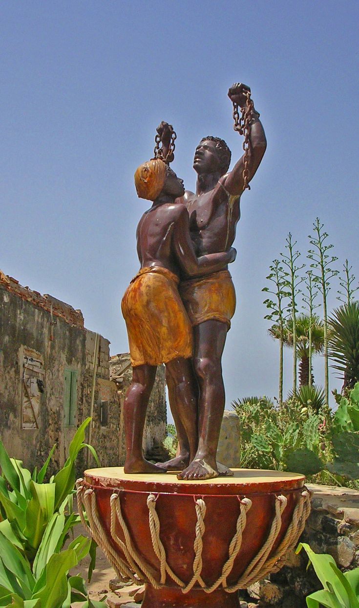 statue of freed slaves on Goree Island (Ile Gorée) in West Africa (An island west of Senegal and belonging to Senegal)