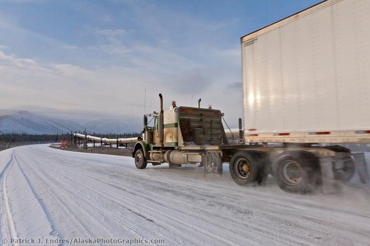 Semi tractor trailer travels the James Dalton Highway in Alaska's arctic.