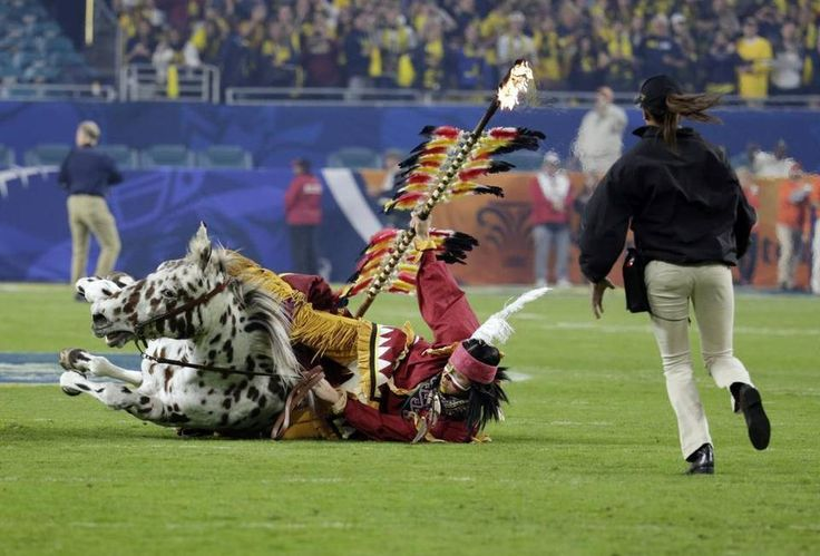 The Florida State mascot Osceola falls from the horse during a pre-game festivity before the first half of the Orange Bowl NCAA college football game against Michigan, Friday, Dec. 30, 2016, in Miami Gardens, Fla.