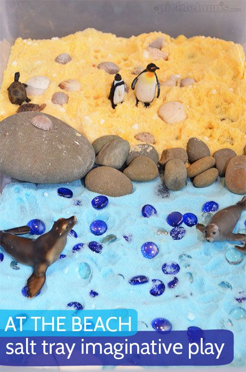 A fun salt tray imaginative play scene with coloured salt and sea creatures!