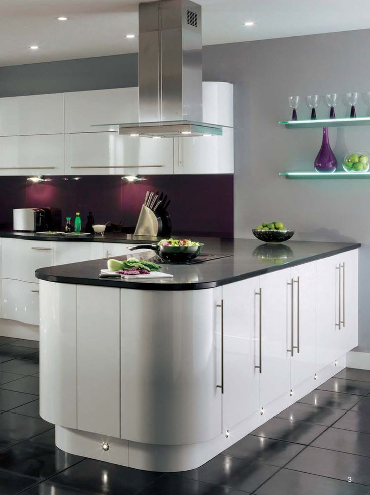 Curved white kitchen units
