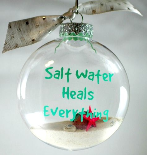 Handmade Coastal Christmas Ornaments 2015: http://www.completely-coastal.com/2015/11/sea-inspired-coastal-christmas-collections.html Filled Clear Ornament with Ocean Quote.