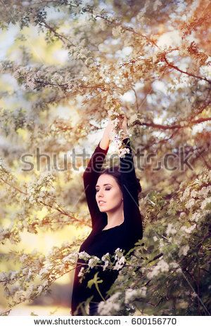 Beautiful Graceful Woman in Spring Blossom Enjoying the Flowers - Lovely  girl in springtime wonderful nature