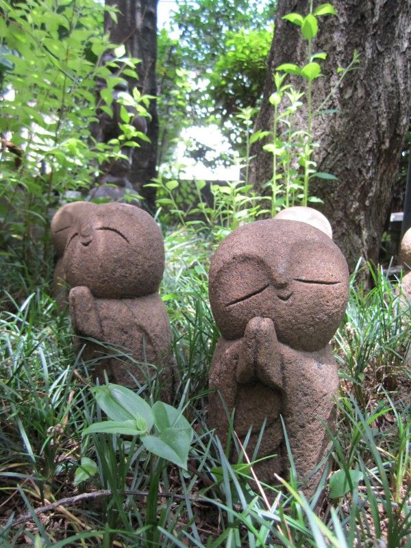 adorable jizo in wooded area
