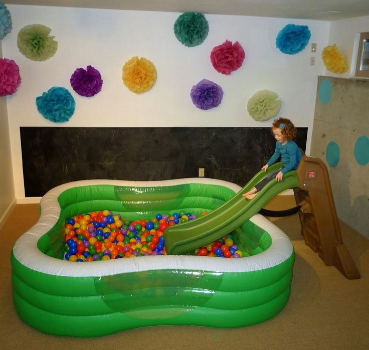 I don't know that it needs to be this big, but a ball pit could be a great addition to the 5 & Under room. Using an inflatable pool & the nursery slide could keep storage to a minimum!