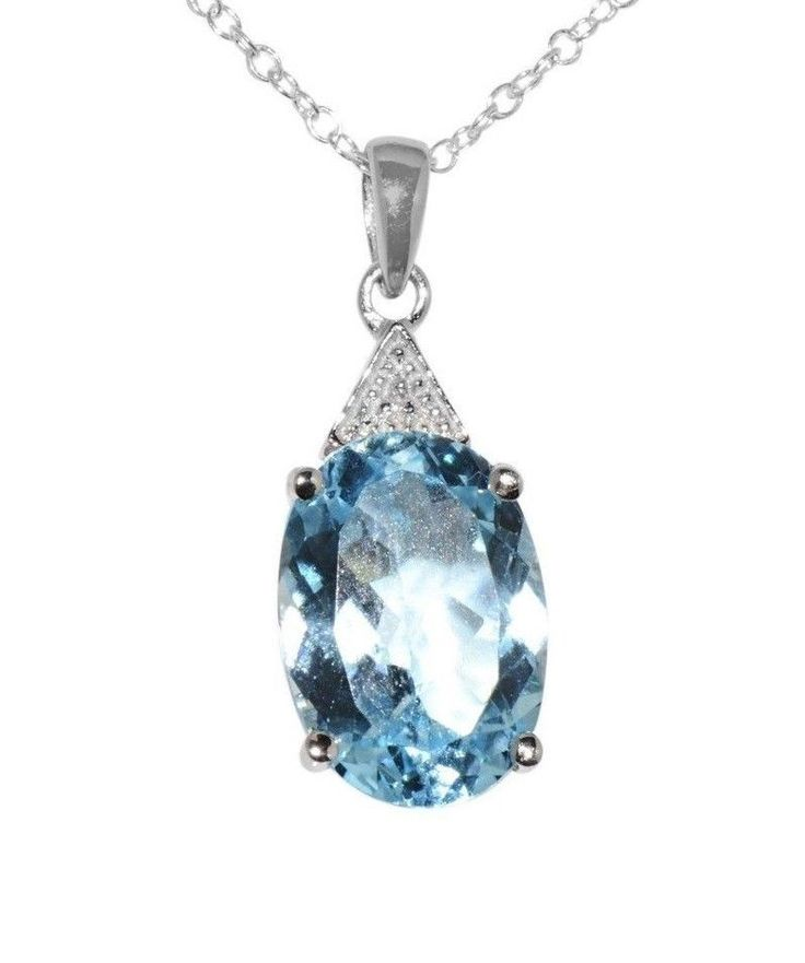 """Beautiful Genuine Diamond and Blue Topaz Pendant Necklace Genuine Diamond .003ct Genuine Blue Topaz 7ct 925 Sterling Silver 18"""" Chain Pendant Rhodium Plated to help prevent tarnish Pendant 25mm high x"""