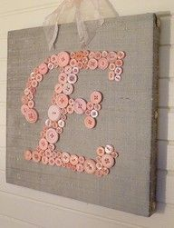 Button letters on a canvas. I want to make burlap Christmas stocking and monogram them like this.