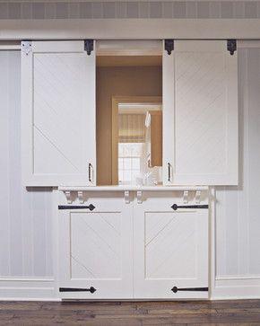 "HDA Project 907 - traditional - hall     Very interesting! Sliding ""barn door/dutch door"" with storage underneath!"