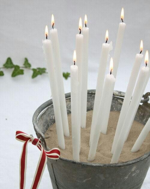 Sand-filled galvanized bucket as a candle holder - Decorate bucket with bows and boughs!