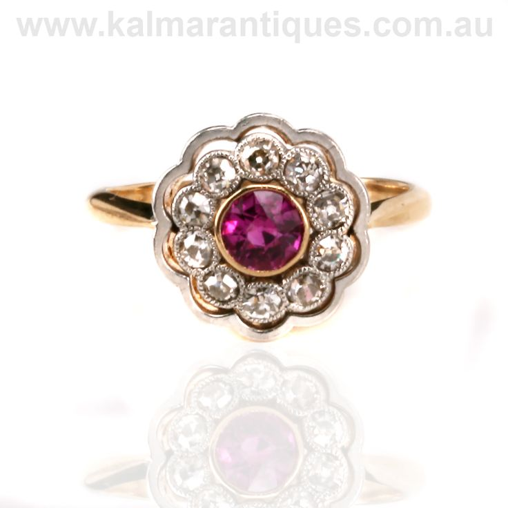 https://www.kalmarantiques.com.au/product/art-deco-ruby-and-diamond-cluster-ring-2/ | A stunning Art Deco 18ct gold, platinum, ruby and diamond ring | Priced at $5,450