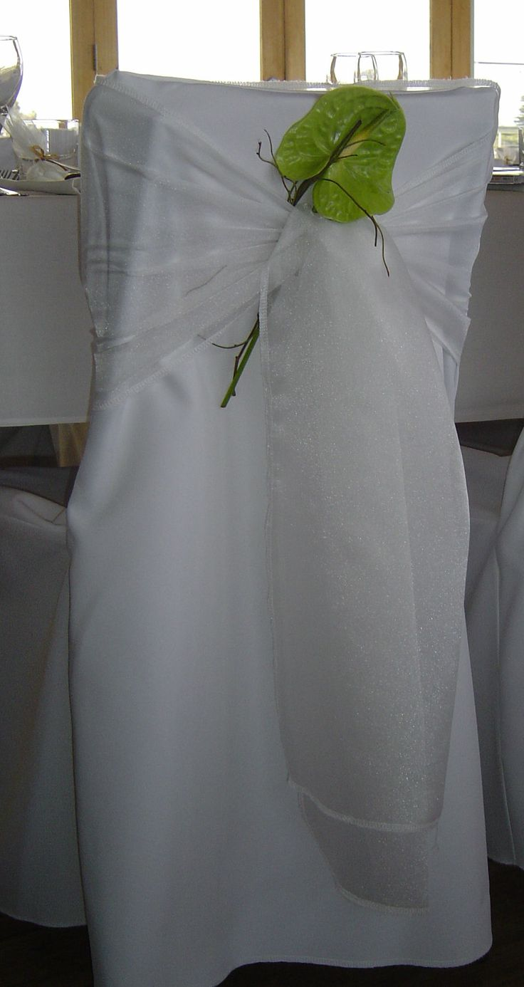 #chaircover #whitechaircoverwithflower  #simplebutelegant by www.newminsterfunctiondesign.com