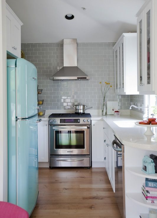 the shelving on the end of the counter/bottom cabinet is great. same colored counter/cabinets with an accent color and light wood floors makes it look airy.