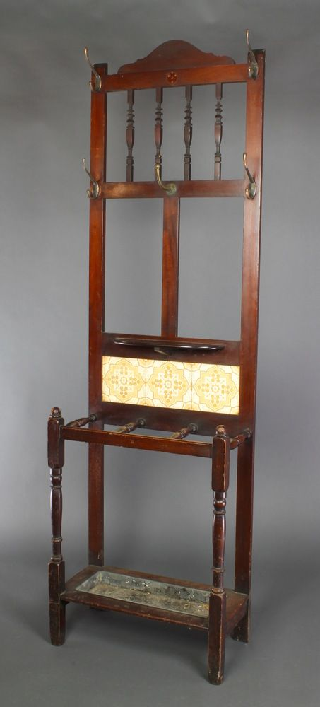 """Lot 854, A Victorian mahogany hall stand with bobbin turned decoration, the tiled back complete with drip tray 71""""h x 22""""w x 10 1/2""""d, est £50-100"""