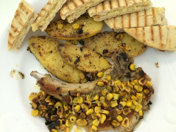 Grilled marinated pork steak with corn and stuffed  greek pita with edam cheese