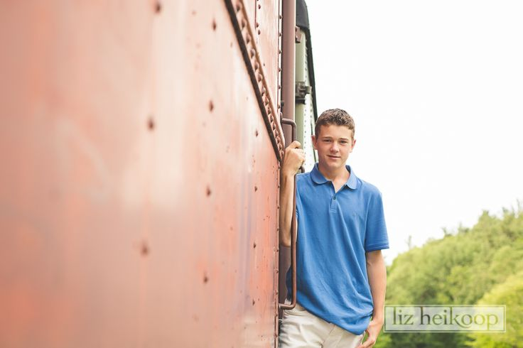 Young man on rail car l Family Train Session l Liz Heikoop Photography