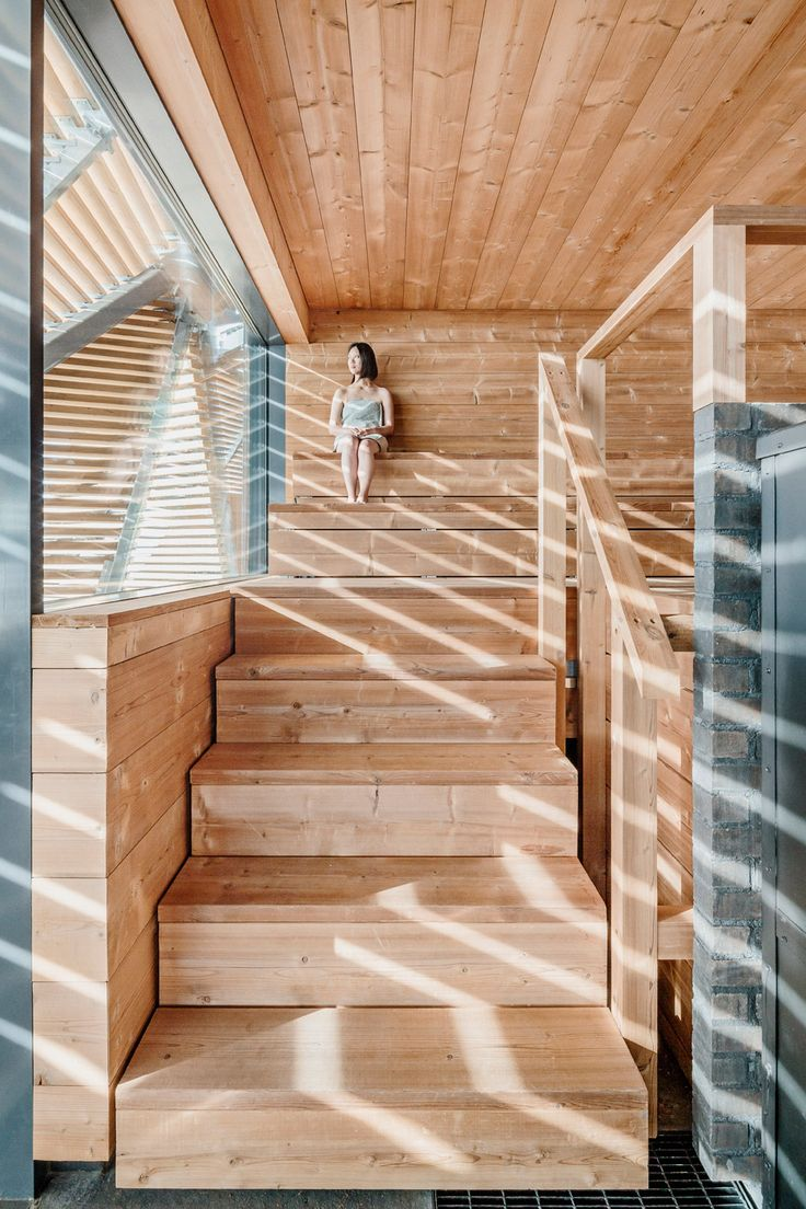 Wooden slats and bleachers provide the multi-faceted volume of this waterfront sauna by Avanto Architects, allowing visitors to climb the roof for a better view of the sea or to lounge in the sun.