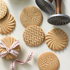 Brown butter sugar cookies decorated with cookie stamps and glazed.