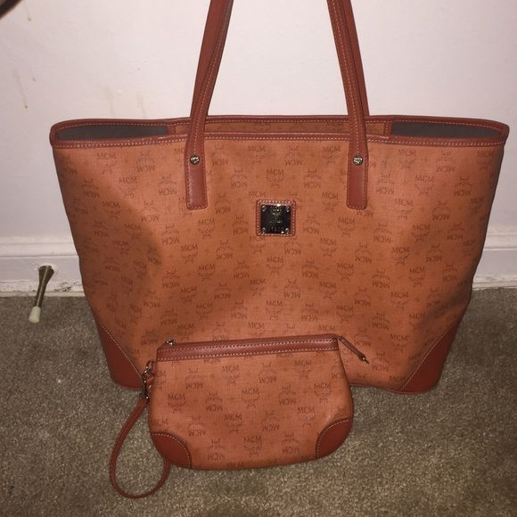 AUTHENTIC Limited edition MCM bag Very good condition I barley ever wear it the stain will be wiped out comes with pouch!...... Will trade for another MCM bag MCM Bags Totes