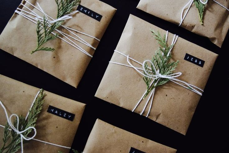 Easy, pretty gift wrap idea! Brown craft paper tied with white cotton twine and a sprig of greenery. Use a retro embossing label maker to create personalized gift tags! Link to the exact label maker provided in the blog post.