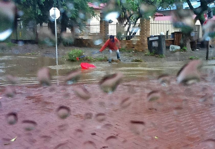 Soweto, ECape Floods | A resident of Port St. John's tries to recover an umbrella from floodwaters in the Eastern Cape town, 21 April. | Photo MEC Mlibo Qoboshiyane / eNCA
