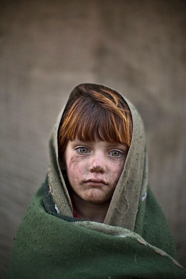 Der Kriegsfotograf Muhammed Muheisen portraitiert afghanische Flüchtlingskinder