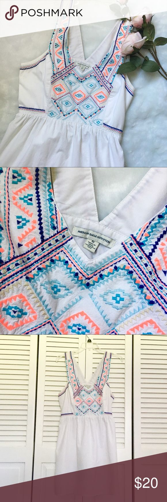 American Eagle Neon Aztec Embroidered Dress! 🦋 Pretty white American Eagle dress with neon colored embroidery! // Cute Aztec prints! // Unique back with semi-crossed straps and a cut out in the back // Goes to a little above the knee. Zipper on the side. // Can fit size 10 and smaller! // Perfect for a beach cover-up! // Minor pilling under the arms. Great used condition overall! American Eagle Outfitters Dresses