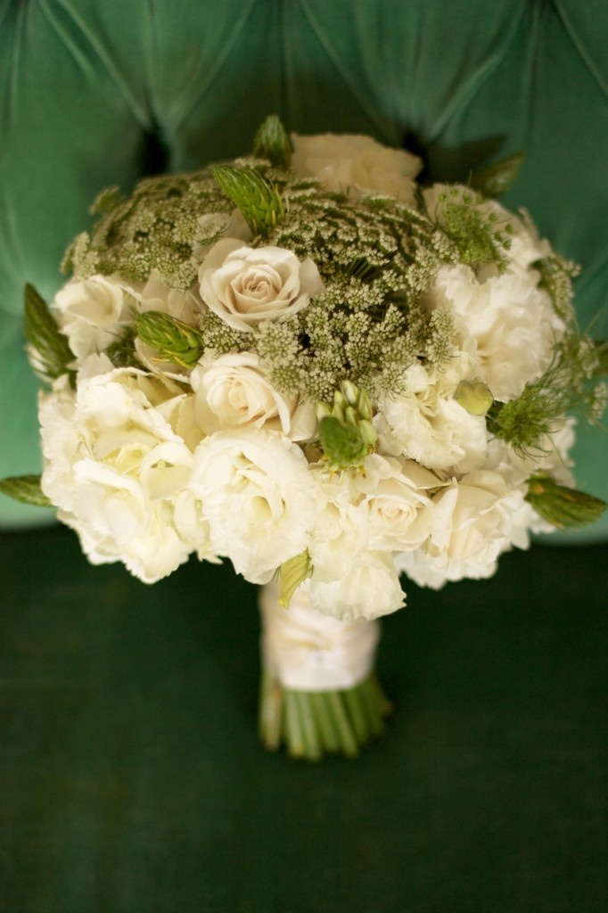The bridal bouquet featured white lisianthus, white spray roses, Queen Anne's Lace and white ornithogalum.