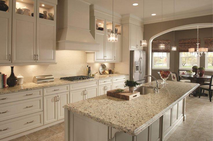 Crema caramel granite countertops with backsplash google for Pearl white kitchen cabinets