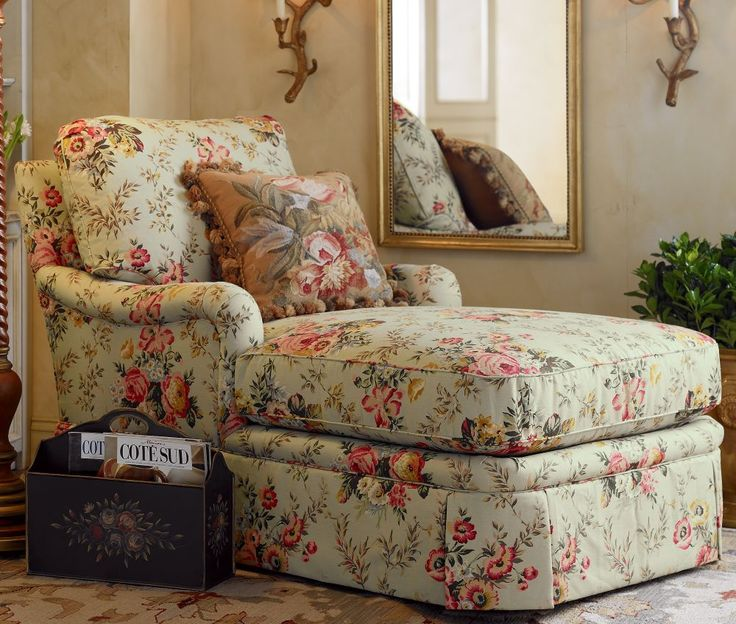 Chaise with floral upholstery. Love the pillow also.