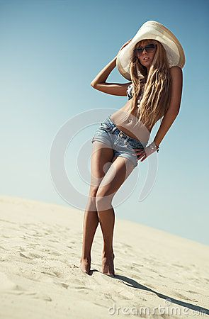 Young slim woman on beach.