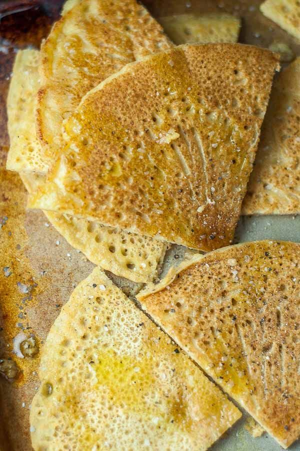Socca flatbread is a naturally gluten free and healthy flatbread recipe made with chickpea flour and can be used for a great tasting gluten free pizza crust. So easy and tasty! http://www.mamagourmand.com