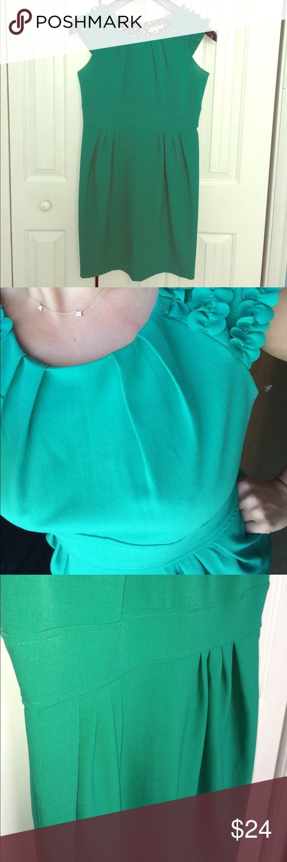 HOLIDAY Green Dress with Petals Pleating in just the right places to accentuate curves.  Sleeveless with almost cap sleeves. Hidden back zipper with a flattering scoop neckline. So fun for the holidays or spring. Dress it up or let the sleeves do all of the work! Sandra Darren Dresses Midi