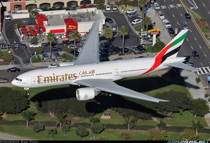 I want a hamburger with whole grill onion and an order of animal fries to go !!!! Boeing 777-21H/LR at  In-N-Out drive thru.